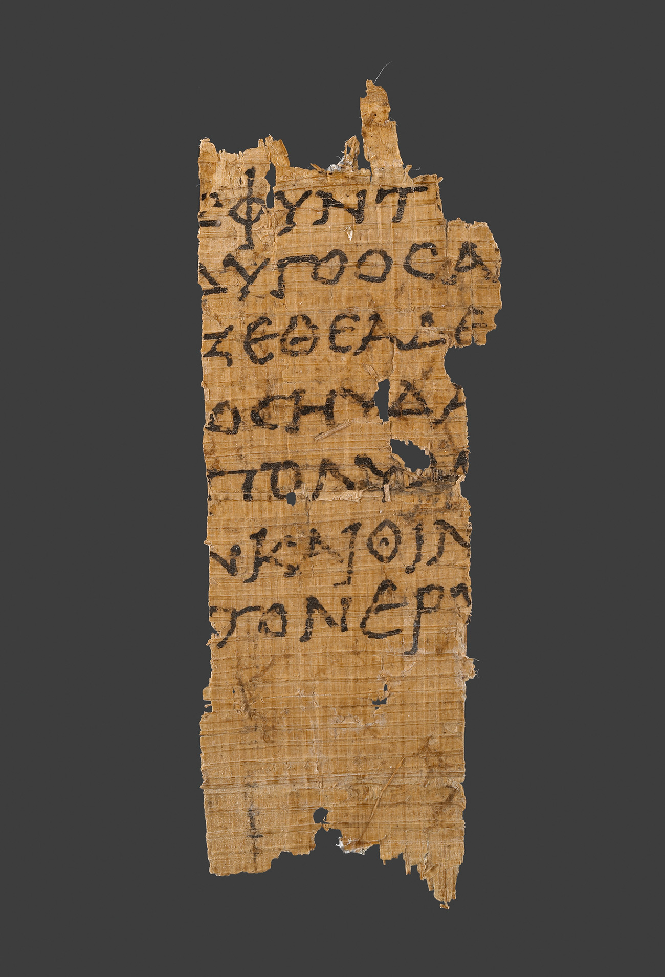 Narrow fragment of papyrus with seven lines of Greek letters. The width of the fragment is about seven letters across.