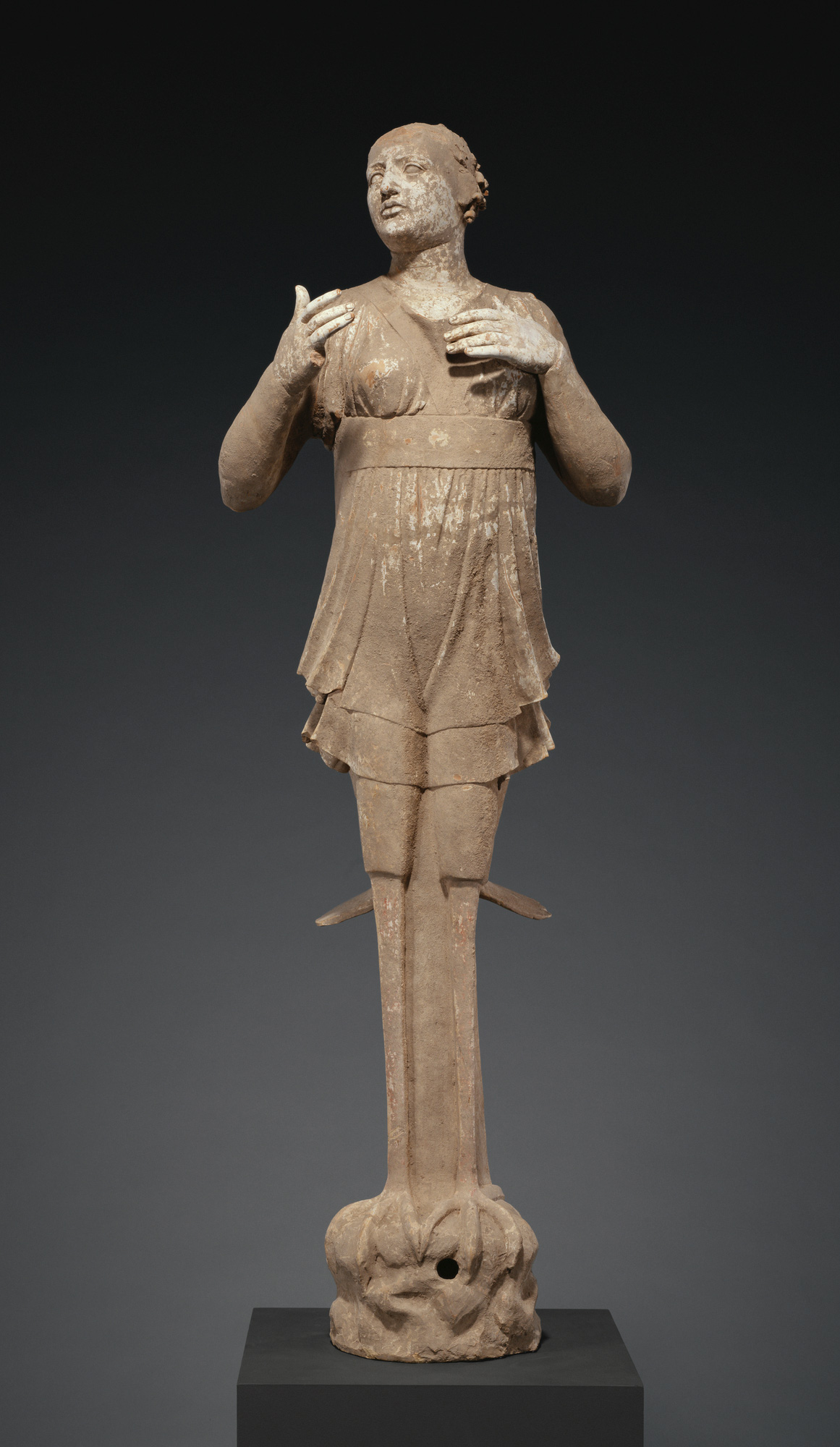 Woman in a short tunic with legs and feet of a bird