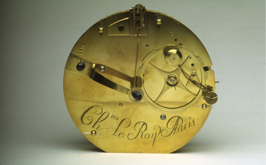 Circular brass object with gears, engraved with Ch Le Roy Paris