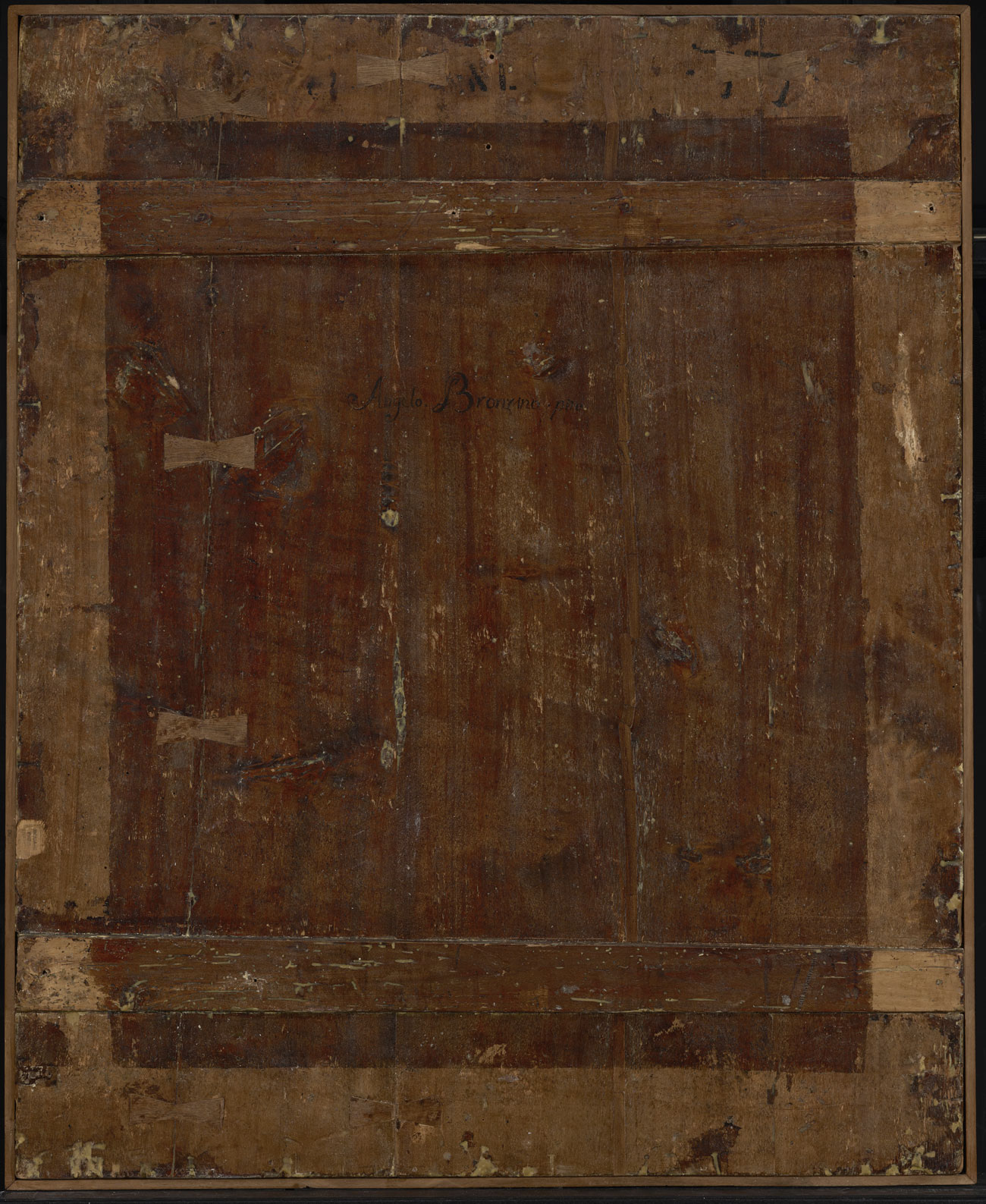 Wooden panel, with lighter wood creating a border around darker wood