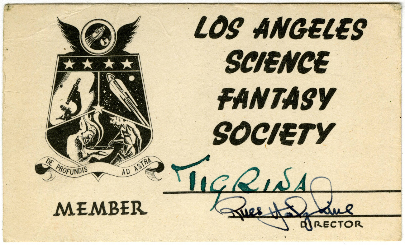Membership card that says Los Angeles Science Fantasy Society with the member signature Tigrina, and an icon of a shield made up of three image: a microscope, a rocket, and monsters stirring a bowl