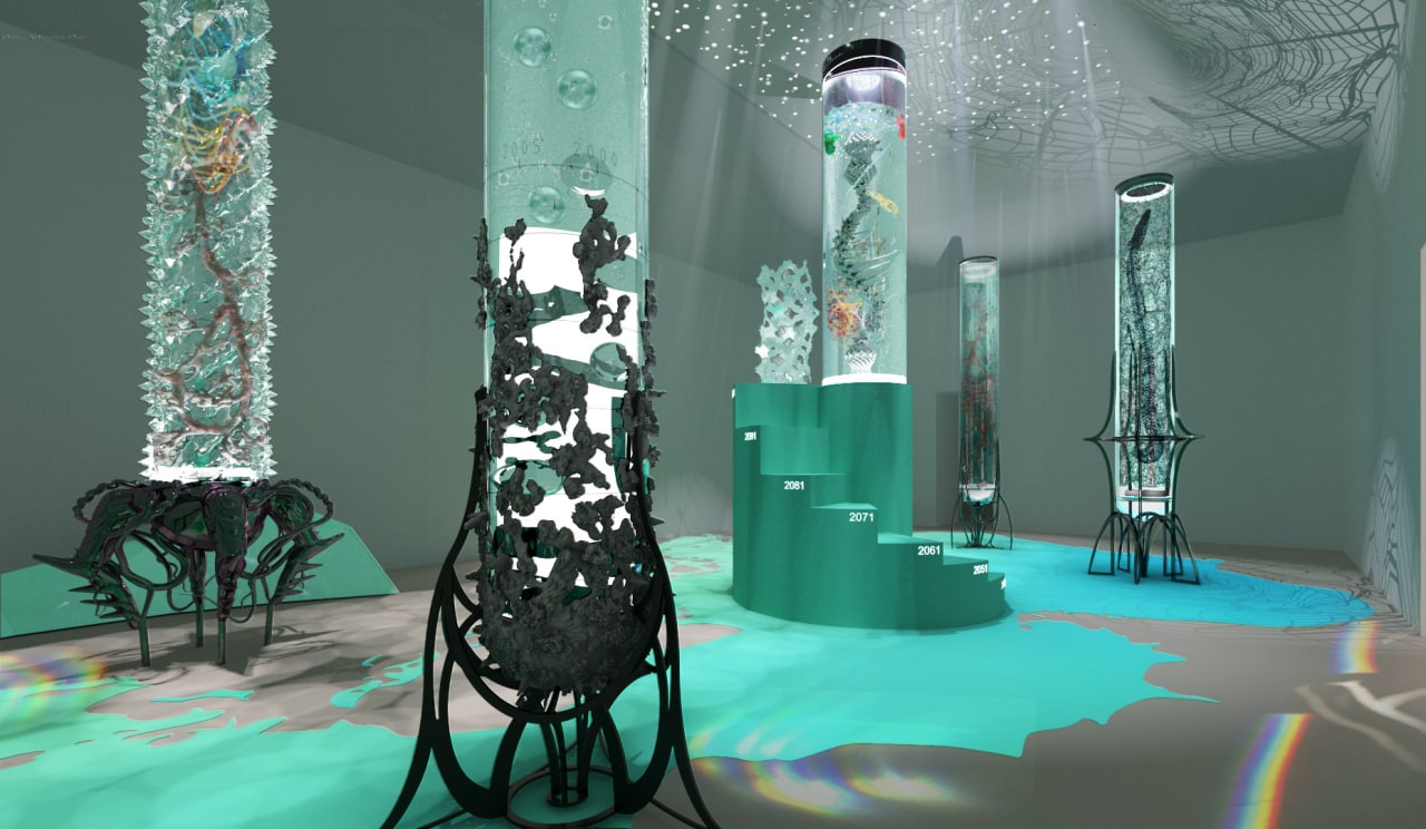 Five glass columns in a room; each column is tinted green and features sculptures inspired by aquatic life inside the glass columns