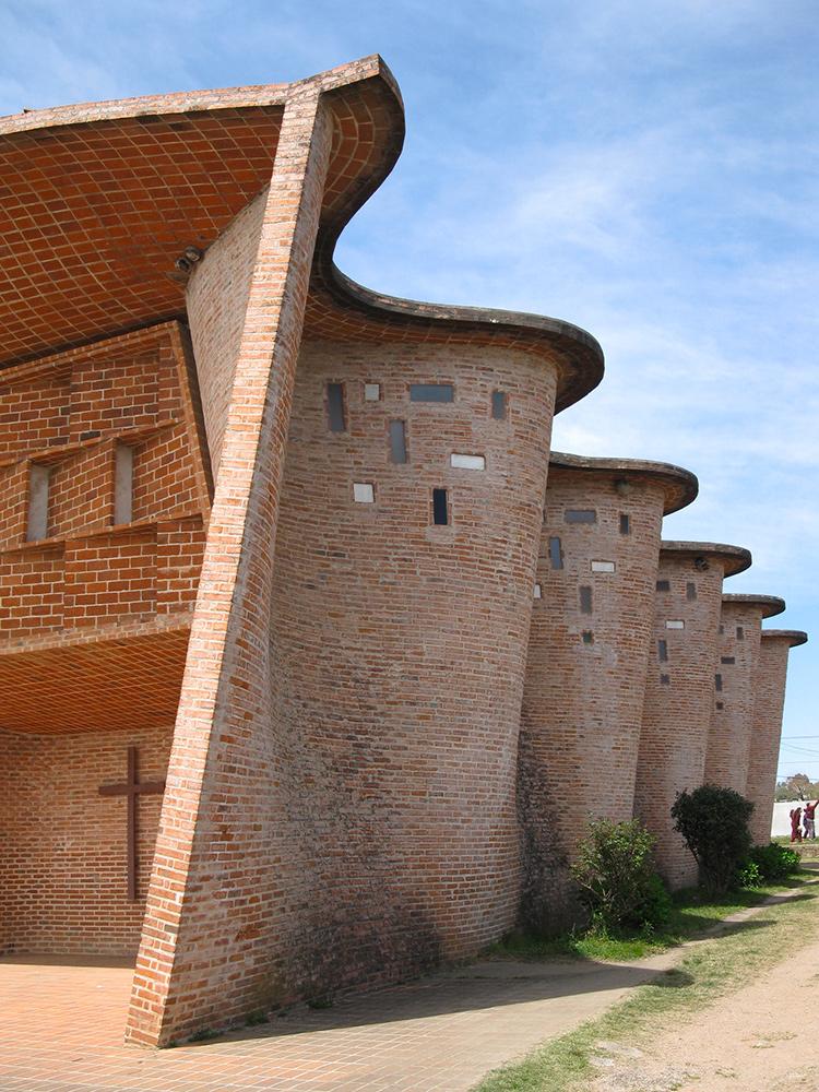 The curved brick walls of the Cristo Obrero church