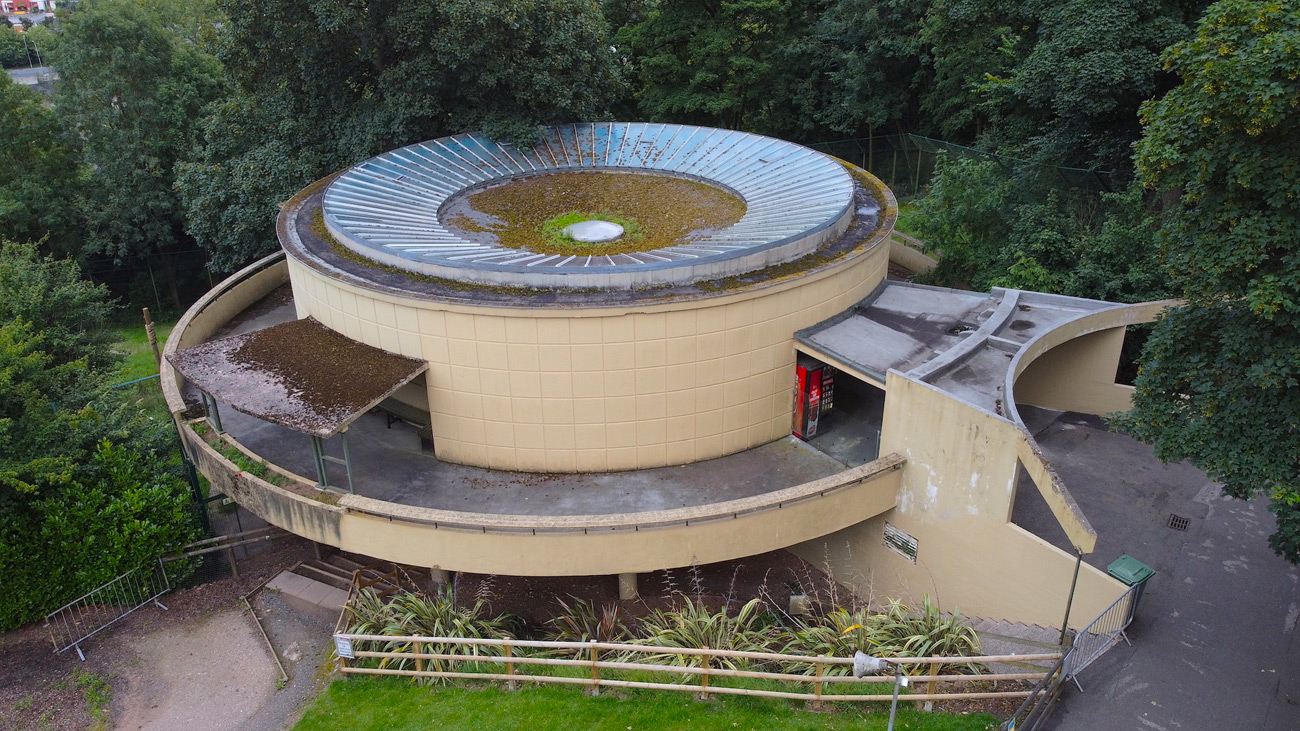 Aerial view of the Concrete round building that houses birds at the Dudley Zoo