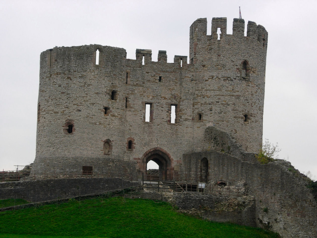 Small, stone castle stands on a hill.