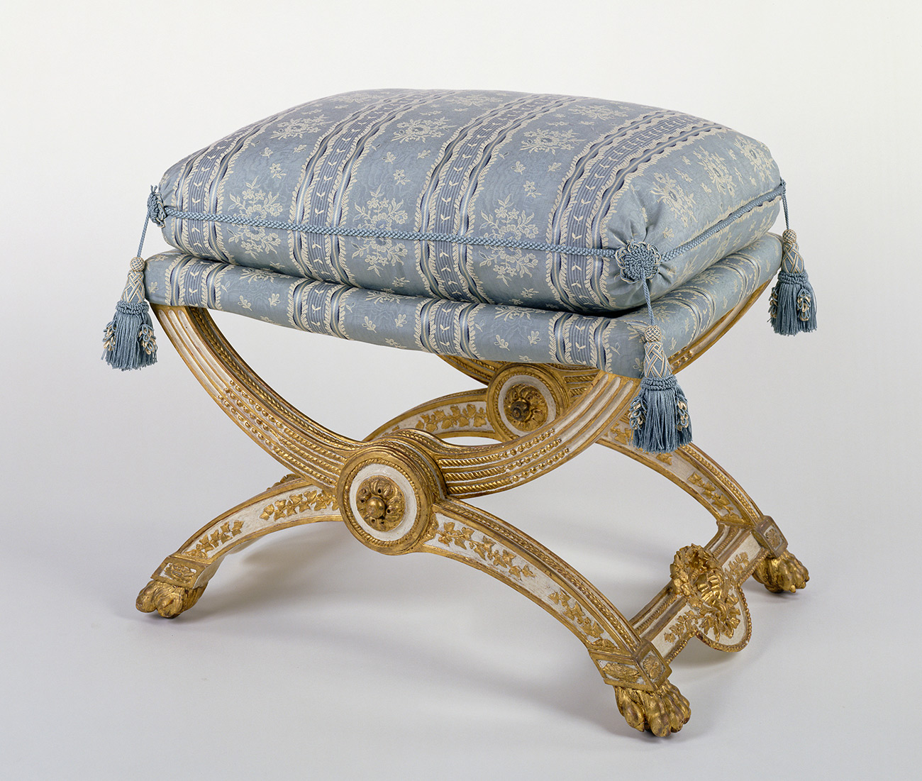 Antique folding stool with light blue cushion